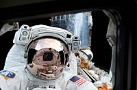 STS_109 spacewalk. American astronaut John M. Grunsfeld during extravehicular activity EVA, or spacewalk as part of the space shuttle mission STS_109....
