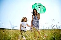 Woman with daughter holding umbrella