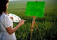 Woman painting in wheat_field
