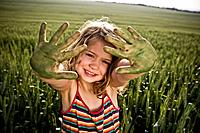 Girl with painted green hands