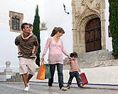 Family taking stroll with shopping bags