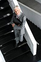 Businessman standing on stairs
