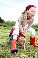 Two children playing leapfrog (thumbnail)