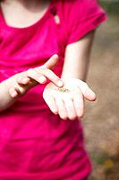 Young girl holding seeds