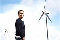Man on wind farm (thumbnail)