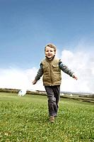 Boy running with windmill