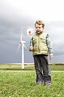 Boy with windmill on a wind farm