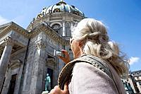 Woman taking picture of church