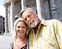Portrait of couple in front of church