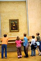 Children at Louvre Museum (Paris, France) viewing the 'Mona Lisa' painting by Leonardo da Vinci