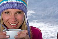 Girl holding cup of tea (thumbnail)