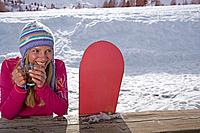 Girl sitting with ski board