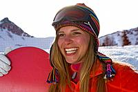 Girl ski smiling with ski board (thumbnail)