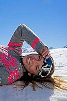 Girl laying on snow