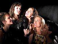 Group of women singing,karaoke