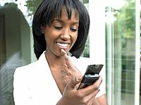 Woman looking at her phone, smiling