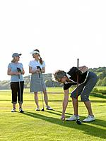 Three golf ladies at tee