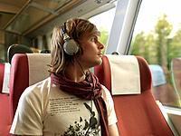 Young man on train (thumbnail)