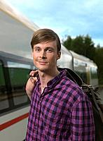 Young man on train station