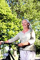 Mature woman with bike (thumbnail)