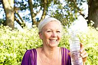 Mature woman with water bottle