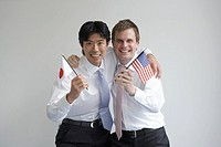 Businessmen Holding Japanese and American Flag
