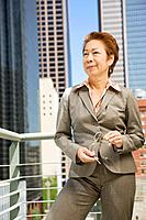 Mature Asian businesswoman outside