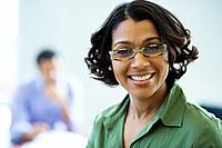 African businesswoman with eyeglasses smiling