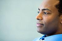 Close up of African businessman looking pensive