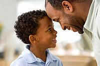 African father and son face to face (thumbnail)