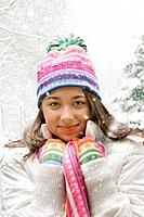 Mixed race girl in stocking cap and scarf outdoors