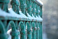 Snow covered wrought iron fence