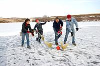 Family playing broomball