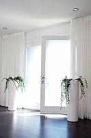 French doors with potted plants on either side