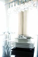 Place settings for four stacked on table