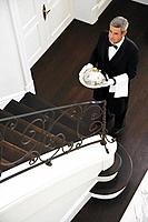 Butler delivering room service