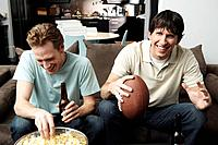 Two men watching football