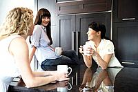 Three women sharing over coffee