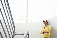 Woman standing in stairway with arms crossed