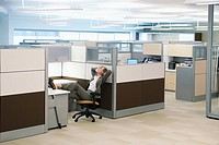 Woman relaxing in a cubicle
