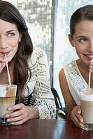 Women enjoying coffee drinks