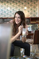 Woman holding coffee drink