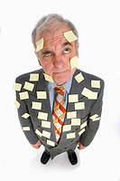 Senior business man covered with adhesive notes