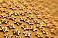 Gold stars on brown background