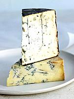Slices of blue cheese on plate