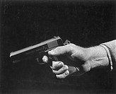 Man holding gun, close up of hand