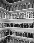 Shelves filled with food in preservation jars