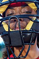 Baseball catcher wearing protective mask, portrait