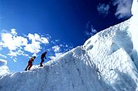 Two people ice climbing, Briksdal glacier, Norway, Fully released