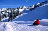 sledging at hut Unterpartnomalpe, Sonnntag, Vorarlberg, Austria